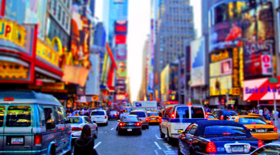 A woman steps into the cacophony of Times Square during the Friday rush hour.